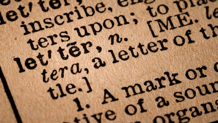 October 1st, 2015 - Montreal, Canada. Close-up of an Old 1945 Webster Vintage Dictionary showing the Word LETTER
