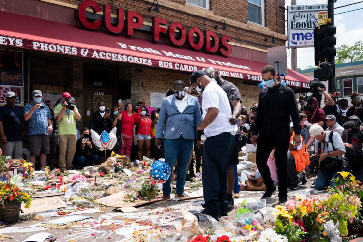 """""""Terrence Floyd, George Floyd's brother visits the location where his brother was killed, now a memorial, at Chicago Ave and E 38th St in Minneapolis, Minnesota"""" by Lorie Shaull is licensed under CC BY-SA 2.0"""